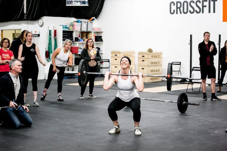 Woman getting last rep in CrossFit Open