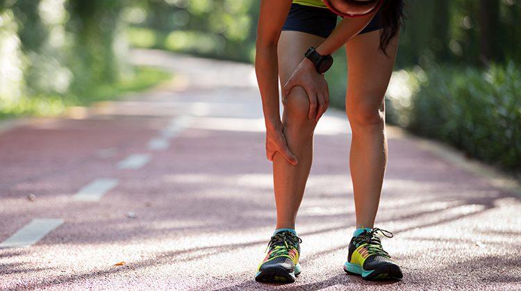 Girl holding shin injury