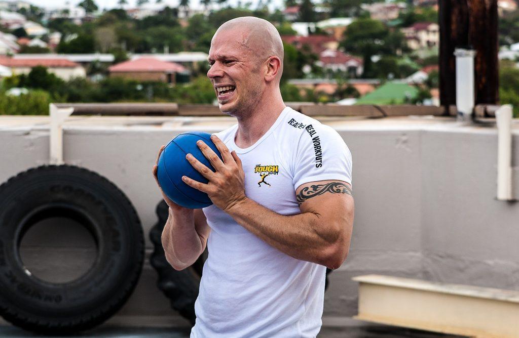 Guy sweating holding ball
