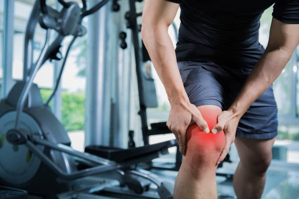 Guy holding inflamed knee