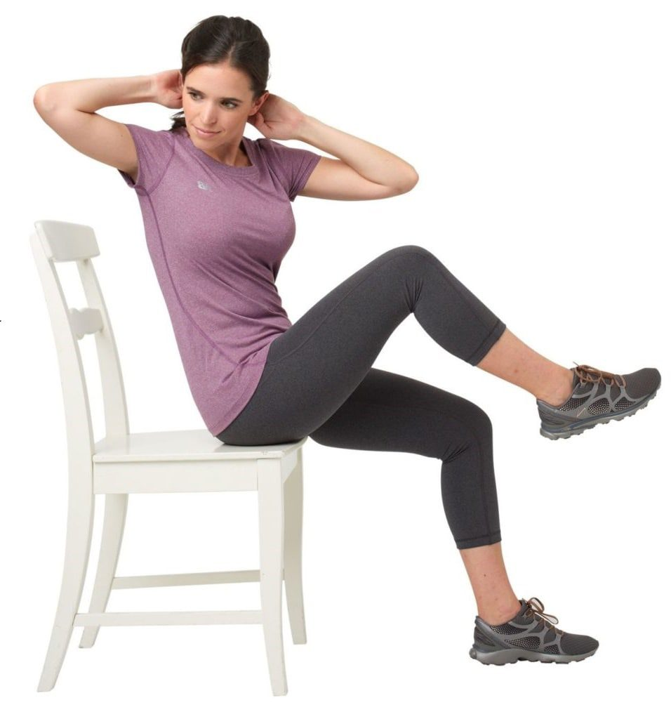 Woman doing knee to elbow in sitting position