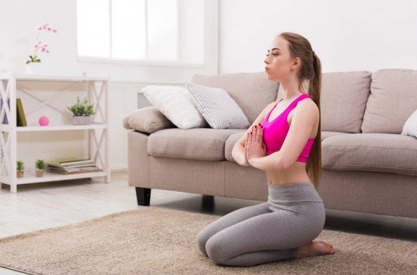 Woman concentrating while performing kneeling squat