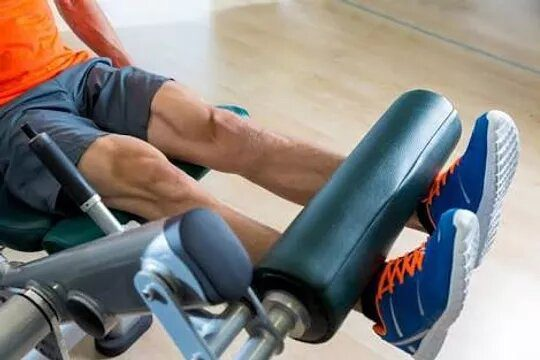 Man performing one of the sissy squat alternatives,Leg extension