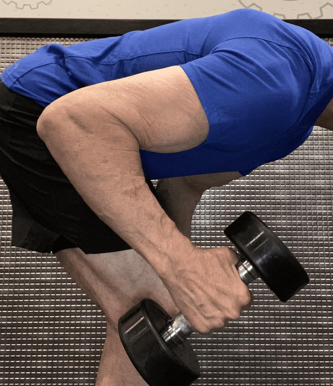 arm flexed for dumbbell lifting kickback