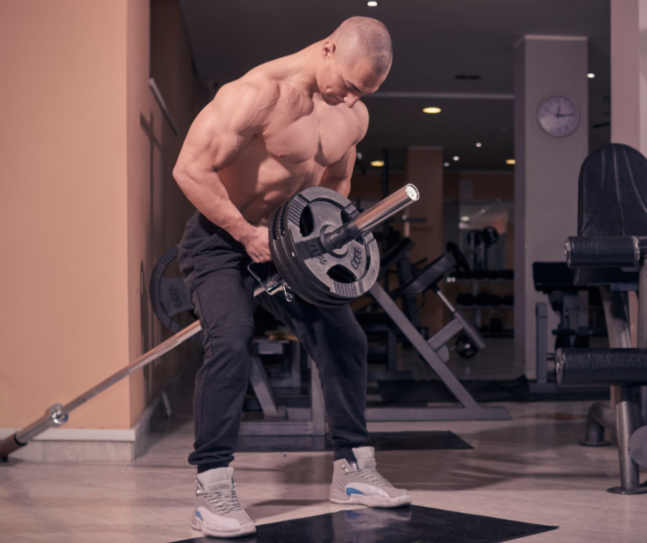 Man performing T-Bar Row for horizontal pulling exercises